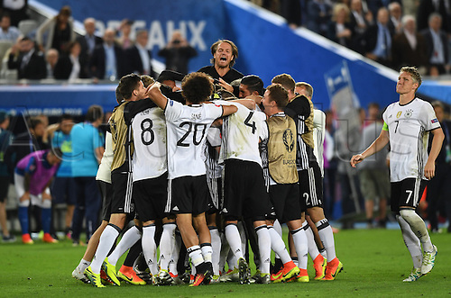 Germany players with Bastian Schweinsteiger (R) and assistant coach Thomas Schneider (top) celebrate after winning the penalty shoot-out of the UEFA EURO 2016 quarter final soccer match between Germany and Italy at the Stade de Bordeaux in Bordeaux, France, 02 July 2016.
