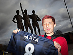 © Joel Goodman - 07973 332324 . 27/01/2014 . Manchester , UK . HUNG-JUI LIN (correct) (27, tourist from Taiwan) poses with his new shirt in front of the United Trilogy statue . Fans with new MATA 8 shirts in front of Old Trafford Football Ground as it's announced that Spaniard Juan Mata ( Juan Manuel Mata García ) has signed for Manchester United  . Photo credit : Joel Goodman