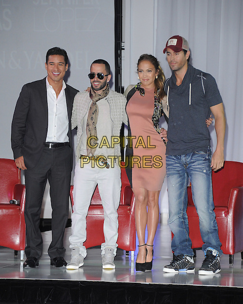 Mario Lopez, Yandel (Llandel Veguilla Malave), Jennifer Lopez, Enrique Iglesias.Jennifer Lopez and Enrique Iglesias with Wisin and Yandel Summer 2012 Tour Press Conference held at Boulevard3, Hollywood, California, USA..April 30th, 2012.full length black pink beige dress microphone ankle strap shoes grey gray top baseball cap hat jeans denim sitting gold metallic snake wrap around collar white                                                               .CAP/RKE/DVS.©DVS/RockinExposures/Capital Pictures.