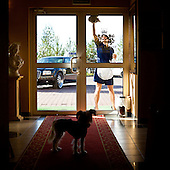 WARSAW, POLAND, NOVEMBER 2011:.Dog watches as woman is cleaning windows at the Venecia Palace Hotel. It was built in 2008 by Polish businessman Waclaw Gozlinski, who concluded that clients, often watching American class B movies and soap operas, are now seeking for fancy, often kitchy interiors for their parties and gatherings..As Poles are getting richer, this place is now the most popular wedding party spot in Poland, which now needs to be booked over a year in advance..(Photo by Piotr Malecki / Napo Images)..Warszawa, Listopad 2011:.Pracowniczka myje okna w hotelu Venecia Palace. Hotel zbudowal w 2008 roku biznesmen Waclaw Gozlinski, gdy zauwazyl, ze Polacy coraz czesciej preferuja kiczowate wesela w ociekajacych sztukateria wnetrzach jak w Las Vegas lub telewizyjnych operach mydlanych. Hotel jest ogromnym sukcesem, czesto trzeba go rezerwowac z ponad rocznym wyprzedzeniem..Fot: Piotr Malecki / Napo Images