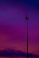 A communication tower is silhouetted against a colorfull sunset in Rouyn-Norenda in Abitibi, Quebec,  November 21, 2009. Rouyn-Noranda (2006 population 39,924) is a city on Osisko Lake in northwestern Quebec, Canada.
