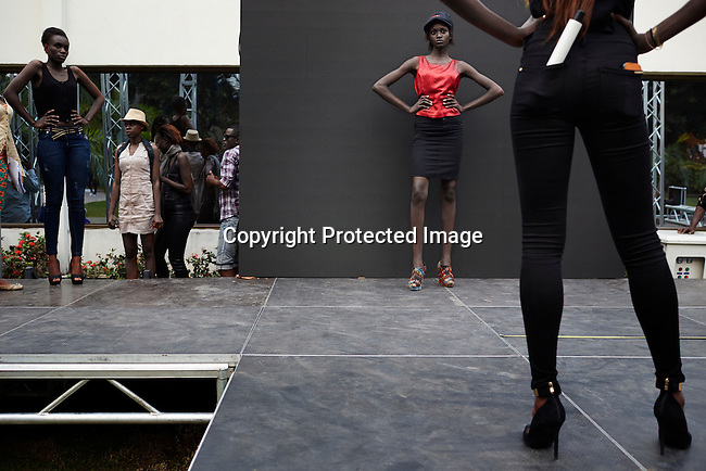KINSHASA, DRC - JULY 17: Models rehearse a day before Kinshasa Fashion Week on July 17, 2014, at Shark club in Kinshasa, DRC. Local and invited foreign-based designers showed their collections during the second edition of Kinshasa Fashion week. Vanessa Nsul Kilem, age 21, (in hat) dreams of becoming a super model. She has won local beauty pageants and she was one of 2000 girls casting for the thirty spots to participate in Kinshasa Fashion Week at Shark club in Kinshasa, DRC. (Photo by Per-Anders Pettersson)