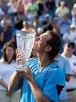 David Nalbandian kisses the trophy after winning the Legg Mason Tennis Classic at the William H.G. FitzGerald Tennis Center in Washington, DC.  David Nalbandian defeated Marcos Baghdatis in straight sets in the finals Sunday afternoon.