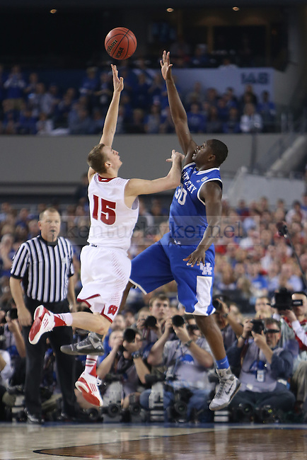 Kentucky Wildcats forward Julius Randle (30) attempts to block Wisconsin Badgers forward Sam Dekker (15) during the NCAA Final Four vs. Wisconsin at the AT&T in Arlington, Tx., on Saturday, April 5, 2014. Photo by Emily Wuetcher | Staff