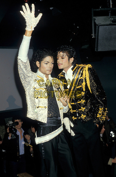 MICHAEL JACKSON & WAXWORK.At Madame Tussauds,.London, March 1985.half length black white gold sparkly sequin military jacket .www.capitalpictures.com glove wax model fake wave waving.sales@capitalpictures.com.©Capital Pictures