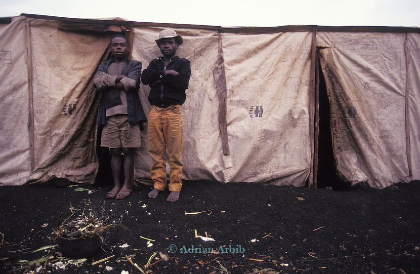Forest  pygmies forcibly relocated due to the fighting   along the Rwanda/ Zaire border are  housed in temporary accomodation in the  refugee camps in Goma, Zaire.