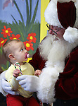 Sophia Guzman, 11 months, sits with Santa during Storytime at the Carson City Library on Thursday, Dec. 13, 2012. .Photo by Cathleen Allison