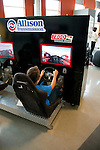 USA, Indiana, Indianapolis Motor Speedway, simulation drive in Indy 500 car at Dellara car manufacturing facility showroom..