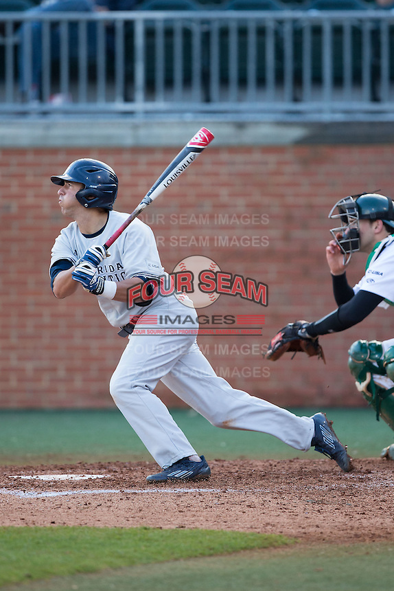 Brett Lashley (12) of the Florida Atlantic Owls follows through on his swing against the Charlotte 49ers at Hayes Stadium on March 14, 2015 in Charlotte, North Carolina.  The Owls defeated the 49ers 8-3 in game one of a double header.  (Brian Westerholt/Four Seam Images)