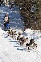 Musher Brennan Norden on Long Lake at the Re-Start of the 2011 Iditarod Sled Dog Race in Willow, Alaska.