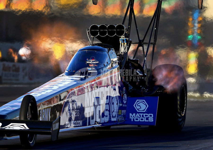 Nov 7, 2013; Pomona, CA, USA; NHRA top fuel dragster driver Antron Brown during qualifying for the Auto Club Finals at Auto Club Raceway at Pomona. Mandatory Credit: Mark J. Rebilas-