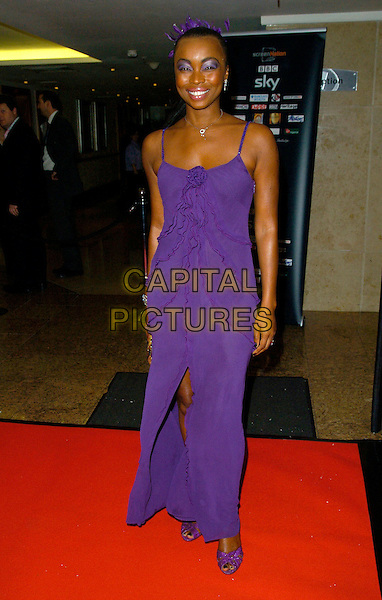 PHINA ORUCHE .Screen Nation Film & Television Awards 2007, Hilton London Metropole, London, England, October 15th 2007. full length purple dress slit split ruffles shoes.CAP/CAN.©Can Nguyen/Capital Pictures