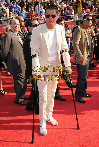 CRISTIANO RONALDO.The 2008 ESPY Awards held at The Nokia Center in Los Angeles, California, USA..July 16th, 2008              .full length white cream suit sunglasses shades crutches .CAP/DVS.©Debbie VanStory/Capital Pictures.