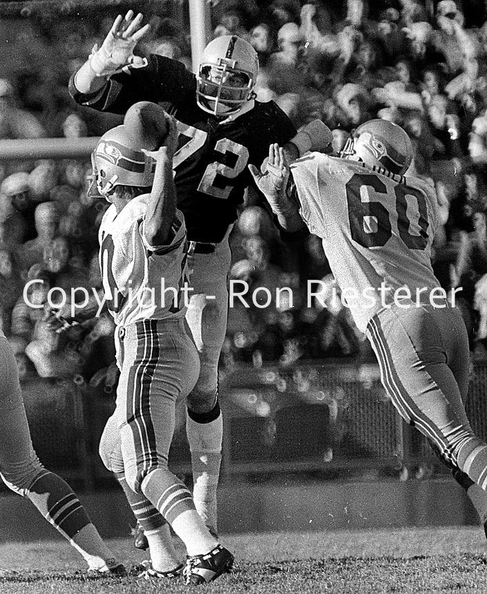 Raiders John Matuszak on top of Seattle Seahawks  <br />QB Jim Zorn, help from #60 Ron Coder.(1977 photo/Ron Riesterer)