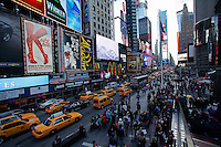 People visit Times Square during the fist day of Spring in New York City. March 20, 2014. Photo by Eduardo Munoz/VIEW