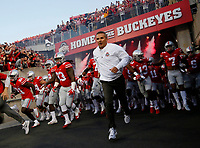 Ohio State Buckeyes head coach Urban Meyer leads his team onto the field prior to the NCAA football game against the Oklahoma Sooners at Ohio Stadium in Columbus on Sept. 9, 2017. [Adam Cairns/Dispatch]