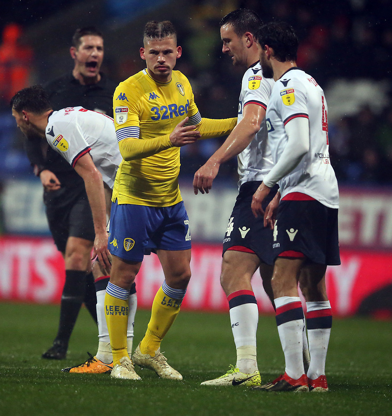 Leeds United's Kalvin Phillips closely marked by Bolton Wanderers' Jack Hobbs as they wait for a corner kick<br /> <br /> Photographer Stephen White/CameraSport<br /> <br /> The EFL Sky Bet Championship - Bolton Wanderers v Leeds United - Saturday 15th December 2018 - University of Bolton Stadium - Bolton<br /> <br /> World Copyright © 2018 CameraSport. All rights reserved. 43 Linden Ave. Countesthorpe. Leicester. England. LE8 5PG - Tel: +44 (0) 116 277 4147 - admin@camerasport.com - www.camerasport.com