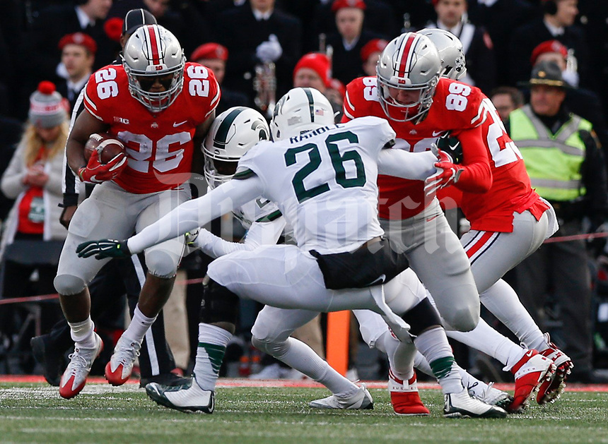 Ohio State Buckeyes running back Antonio Williams (26) runs the ball during the fourth quarter of a NCAA college football game between the Ohio State Buckeyes and the Michigan State Spartans on Saturday, November 11, 2017 at Ohio Stadium in Columbus, Ohio. [Joshua A. Bickel/Dispatch]