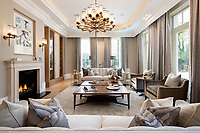 BNPS.co.uk (01202 558833)<br /> Pic: Savills/BNPS<br /> <br /> Main lounge.<br /> <br /> Fairway to Heaven - Hills End has been described as 'a fabulous new masterpiece'. <br /> <br /> This breathtaking brand new mansion only a pitching wedge from one the most exclusive golf clubs in the country has emerged for sale for a whopping £22m.<br /> <br /> Hills End nestles within the prestigious Sunningdale estate in Surrey, home of the £4,000 a year Sunningdale Golf Club which dates back to 1900 and has hosted the Women's British Open and the Senior Open Championship.<br /> <br /> The newly-built property sits on a 1.75 acre plot  boasting six bedrooms, eight reception areas, a swimming pool complex with spa, sauna and yoga rooms along with a large cinema. and walk in wardrobes.<br /> <br /> The incredible Palladian style home is on the market with estate agents Savills who describe it as 'a fabulous new masterpiece'...that comes with a whopping £22 million price tag.