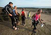 27 JUL 2013 - CROMER, GBR - Maria Greaves (right) walks away from body marking to prepare for the swimstart of The Anglian Triathlon from West Runton to Cromer, North Norfolk, Great Britain (PHOTO COPYRIGHT © 2013 NIGEL FARROW, ALL RIGHTS RESERVED)