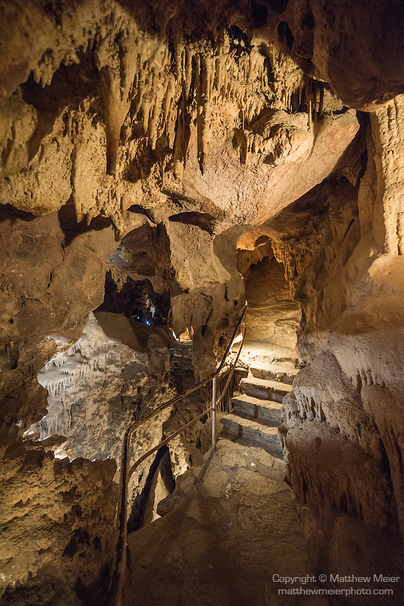 Colossal Cave Mountain Park, Vail, Arizona; photo of the cave near the Sink Hole, views inside Colassal Cave include cave formations such as stalactites, stalagmites, flowstone, boxwork, and helictites