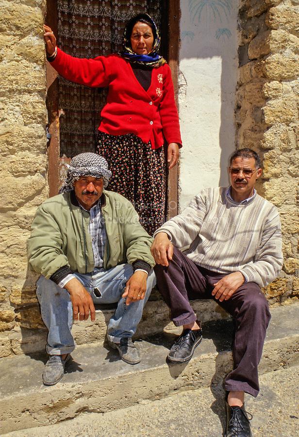 Tunisia, Le Kef.  Hammam Mellegue, Roman Era Baths.  Caretaker (left), Wife, and Friend.