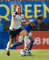 USWNT forward (8) Lauren Cheney powers her way past Italy's (18) Pamela Conti during the last group stage game at the Peace Queen Cup.  The USWNT defeated Italy, 2-0, at the Suwon Sports Center in Suwon, South Korea.
