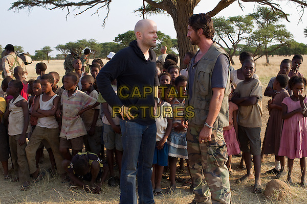Director Marc Forster & Gerard Butler.on the set of Machine Gun Preacher.*Filmstill - Editorial Use Only*.CAP/FB.Supplied by Capital Pictures.