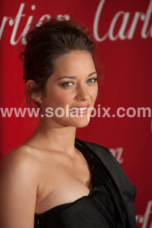 **ALL ROUND PICTURES FROM SOLARPIX.COM**.**SYNDICATION RIGHTS FOR UK, AUSTRALIA, DENMARK, PORTUGAL, S. AFRICA, SPAIN & DUBAI (U.A.E) ONLY**.Arrivals 2010 Palm Springs International Film Festival Awards Gala at the Palm Springs Convention Center,  Palm Springs, CA, USA ..This pic: Marion Cotillard..JOB REF: 10433 PHZ Hatcher   DATE: 05_01_2010.**MUST CREDIT SOLARPIX.COM OR DOUBLE FEE WILL BE CHARGED**.**MUST NOTIFY SOLARPIX OF ONLINE USAGE**.**CALL US ON: +34 952 811 768 or LOW RATE FROM UK 0844 617 7637**