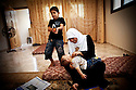 Huda Nae'm, a Hamas lawmaker in Gaza, plays at home with her children [Tanya Habjouqa]