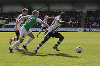 Nigel Hasselbank dispossesses Lewis Stevenson watched by Paul McGowan in the St Mirren v Hibernian Clydesdale Bank Scottish Premier League match played at St Mirren Park, Paisley on 29.4.12.