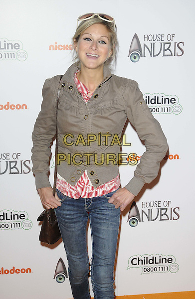 Nikki Grahame.Preview screening of Nickelodeon's 'House of Anubis' Season Two at Freemasons Hall, Covent Garden, London, England..March 11th 2012.half length brown jacket beige jeans denim.CAP/CAN.©Can Nguyen/Capital Pictures.
