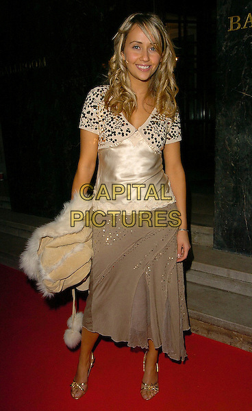 SAMIA GHADIE.Children's Champion Awards at Grosvenor House Hotel, W1, London, UK..November 16th, 2005.Ref: CAN.full length beige silk satin top grey gray skirt pink clutch purse.www.capitalpictures.com.sales@capitalpictures.com.©Capital Pictures