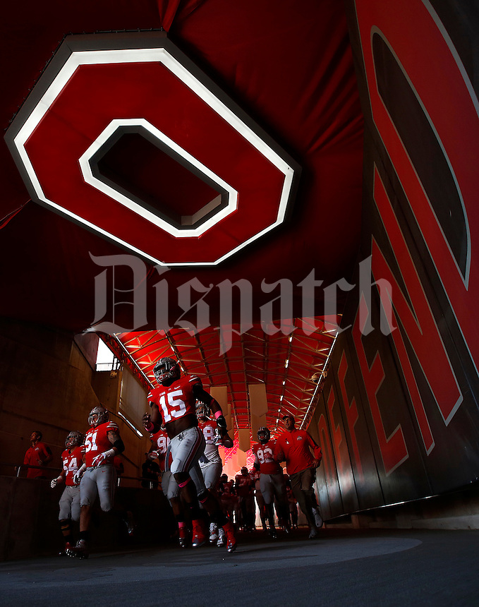 Ohio State Buckeyes running back Ezekiel Elliott (15) runs out of the tunnel for warm ups before the college football game between the Ohio State Buckeyes and the Maryland Terrapins at Ohio Stadium in Columbus, Saturday afternoon, October 10, 2015. (The Columbus Dispatch / Eamon Queeney)
