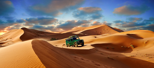 4 x4 Landrover Defnder on the Sahara sand dunes of erg Chebbi at sunset , Morocco, Africa