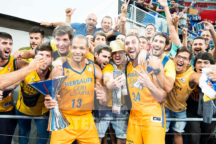 Herbalife Gran Canaria's players Eulis Baez and Pablo Aguilar celebrating the victory with supporters during the final of Supercopa of Liga Endesa Madrid. September 24, Spain. 2016. (ALTERPHOTOS/BorjaB.Hojas)