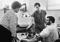 Dr. Michael Glick (center) comforts a young patient in 1989 at the Infectious Disease Clinic at Temple University in Philadelphia, Pennsylvania. The Infectious Disease Clinic at Temple University, was established in 1988 by Dr. Glick to treat people with HIV from throughout the region. (Photo by William Thomas Cain/Cain Images)