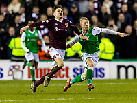 3rd March 2020; Easter Road, Edinburgh, Scotland; Scottish Premiership Football, Hibernian versus Heart of Midlothian; Aaron Hickey of Hearts and Daryl Horgan of Hibernian compete for possession of the ball