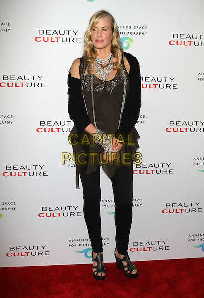 DARYL HANNAH .at The opening of Beauty Culture - a photographic exploration of how feminine beauty is defined, challenged and revered in modern society held at Annenberg Space for Photography in Century City, California, USA,.May 19th 11..full length  black jeans cardigan grey gray top  wedges  vest beaded  silver bracelet cuff  necklace .CAP/ADM/KB.©Kevan Brooks/AdMedia/Capital Pictures.