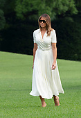 First lady Melania Trump walks on the South Lawn as she and United States President Donald J. Trump return to the White House in Washington, DC after spending a weekend at their residence in Bedminster, New  Jersey on Sunday, July 7, 2019.<br /> Credit: Chris Kleponis / Pool via CNP