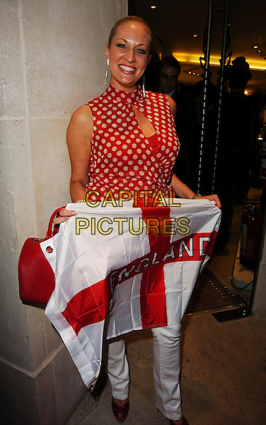 SARAH BOSNICH.Diesel - store launch party, Diesel, 130 New Bond Street, London, UK..May 18th, 2006.Ref: CAN.full length white red polka dot top flag England.www.capitalpictures.com.sales@capitalpictures.com.© Capital Pictures.