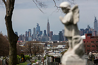 NEW YORK, NY - April 14: View of the Empire State Building from the Linden Hill Methodist Cemetery on April 14, 2020 in Brooklyn, NY. The global number of deaths from COVID-19 has reached 122,000 and infected more than 1.9 million people. Experts believe the number may be greater. (Photo by Pablo Monsalve / VIEWpress via Getty Images)