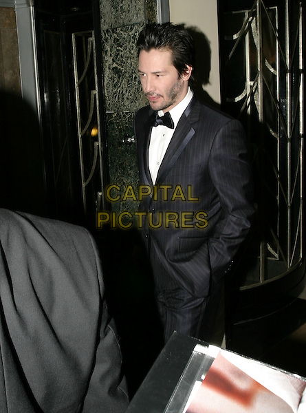 KEANU REEVES.Leaving Claridges Hotel, London, .February 12th 2005..half length.Ref: AH.www.capitalpictures.com.sales@capitalpictures.com.©Capital Pictures.