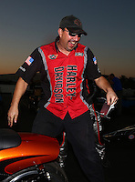 Nov 10, 2013; Pomona, CA, USA; A crew member celebrates with NHRA pro stock motorcycle rider Eddie Krawiec celebrates after winning the Auto Club Finals at Auto Club Raceway at Pomona. Mandatory Credit: Mark J. Rebilas-