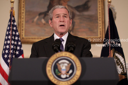 Washington, DC - December 19, 2008 -- United States President George W. Bush makes a statement on the administrations plan to assist automakers restructure their operations and avoid bankruptcy in the Roosevelt Room of the White House in Washington D.C. on Friday, December 19, 2008.  .Credit: Ken Cedeno / Pool via CNP