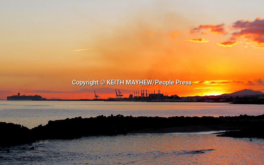 LANZAROTE, CANARY ISLANDS -  Sunset over the beach resort of Costa Teguise during January 2016 in Lanzarote, Canary Islands<br /> <br /> Photo by Keith Mayhew