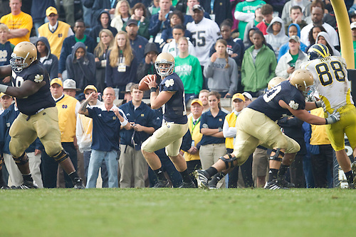 Notre Dame quarterback Dayne Crist (#10) sets to pass during NCAA football game between the Notre Dame Fighting Irish and the Michigan Wolverines.  Michigan defeated Notre Dame 28-24 in game at Notre Dame Stadium in South Bend, Indiana.