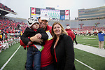 Wisconsin Badgers Mark Tauscher with his wife and son prior to an NCAA Big Ten Conference Football game against the Indiana Hoosiers Saturday, November 16, 2013, in Madison, Wis. The Badgers won 51-3. (Photo by David Stluka)