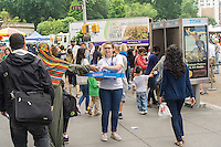 """Thousands of donut lovers flock to Union Square in New York to celebrate  National Donut Day on Friday, June 3, 2016. Supported by Entenmann's, the bakers gave out tens of thousands of chocolate donuts and donated up to $35,000 to the Salvation Army. National Donut Day, the first Friday in June, was created in 1938 by the Salvation Army to honor the """"donut lassies"""" who administered treats and solace to soldiers during WW1. Entenmann's is a division of Bimbo Bakeries USA. (©  Richard B. Levine)"""