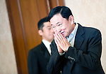 Thaksin Shinawatra, former prime minister of Thailand, makes a traditional greeting prior to a group interview at a hotel in Tokyo, Japan on 23 Aug. 2011. Photographer: Robert Gilhooly